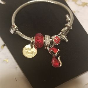 Charm bracelet with red details